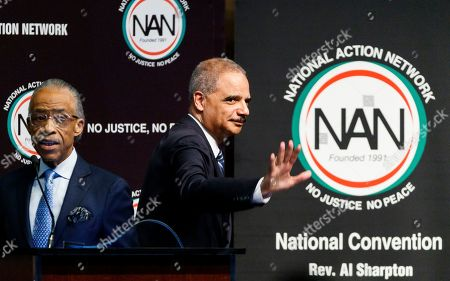 Former US Attorney General Eric Holder (R) acknowledges the crowd after addressing the National Action Network's annual national convention in New York, New York, USA, 03 April 2019. NAN's annual convention, which was founded by Rev. Al Sharpton (L), is a regular stop for politicians and this year is drawing many who have already entered the race to be the next Democratic presidential nominee.