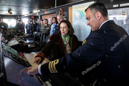 Stock Picture of Spanish Defense Minister, Margarita Robles (C), pays attention to the explanations by Blas de Lezo frigate's commander Juan Carlos Perez Guerrero (R), during her visit to the Naval Station Rota, the new EU operational headquarters for the strategic direction of the Atalanta Operation against piracy in the Indian Ocean, in Rota, province of Cadiz, Spain, 03 April 2019.