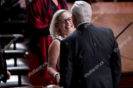 Sen. Kyrsten Sinema, D-Ariz., left, speaks with House Majority Leader Steny Hoyer of Md., before NATO Secretary General Jens Stoltenberg addresses a Joint Meeting of Congress on Capitol Hill in Washington, having been invited by the bipartisan leadership of the House of Representatives and the Senate