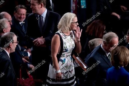 Sen. Kyrsten Sinema, D-Ariz., arrives before NATO Secretary General Jens Stoltenberg addresses a Joint Meeting of Congress on Capitol Hill in Washington, having been invited by the bipartisan leadership of the House of Representatives and the Senate