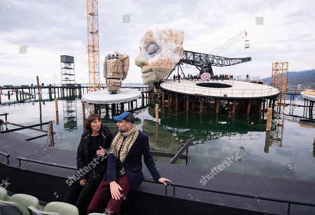 Elisabeth Sobotka (L), director of the Bregenz Festival, and Philipp Stoelzl, director and set designer of the 'Rigoletto' stage talk in front of the scenery for Giuseppe Verdi's opera 'Rigoletto' during its topping out ceremony at the Seebuehne 'lake stage' in Bregenz, Austria, 03 April 2019. The Bregenz Festival 2019 will be held from 17 July to 18 August 2019.