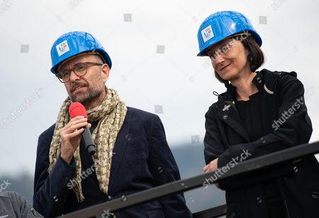 Stock Image of Elisabeth Sobotka (R), director of the Bregenz Festival, and Philipp Stoelzl, director and set designer of the 'Rigoletto' stage stand in front of the scenery for Giuseppe Verdi's opera 'Rigoletto' during its topping out ceremony at the Seebuehne 'lake stage' in Bregenz, Austria, 03 April 2019. The Bregenz Festival 2019 will be held from 17 July to 18 August 2019.
