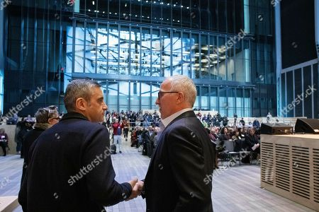 Alex Poots, left, CEO and artistic director of The Shed, shakes hands with board member Frank McCourt, Jr., at a media preview for the arts center at New York's Hudson Yards, . McCourt gave a gift of $45 million and the performance space is named in his honor