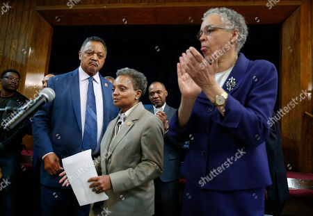 Chicago Mayor-elect Lori Lightfoot is introduced during a news conference as her opponent Toni Preckwinkle, right, and Rev. Jesse Jackson look on during a press conference at the Rainbow PUSH organization, Wednesday morning, in Chicago