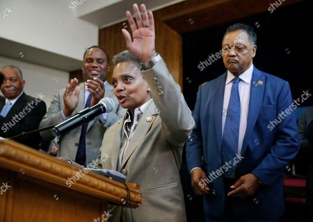 Chicago Mayor-elect Lori Lightfoot, speaks as Rev. Jesse Jackson, right, looks on during a press conference at the Rainbow PUSH organization, Wednesday morning, in Chicago