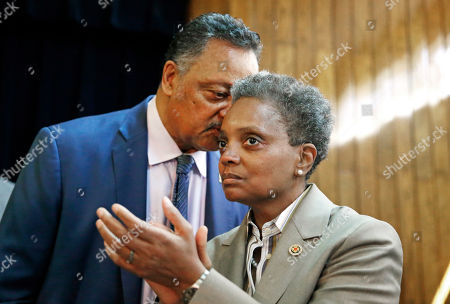 Rev. Jesse Jackson whispers to Chicago Mayor-elect Lori Lightfoot during a press conference at the Rainbow PUSH organization, in Chicago