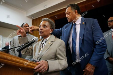 Chicago Mayor-elect Lori Lightfoot speaks as Rev. Jesse Jackson, right, gestures during a news conference at the Rainbow PUSH organization, in Chicago