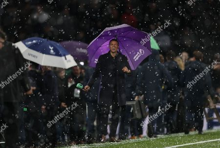 Former Spurs player  Jermaine Jenas laughing during Hail Storm before kick off