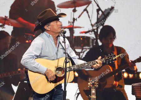 George Strait performs at Loretta Lynn's 87th Birthday Tribute at Bridgestone Arena, in Nashville, Tenn