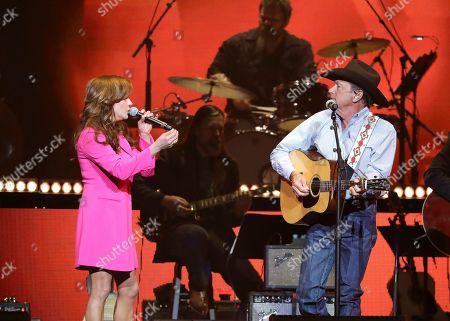 Martina McBride, George Strait. Martina McBride, left, and George Strait perform at Loretta Lynn's 87th Birthday Tribute at Bridgestone Arena, in Nashville, Tenn