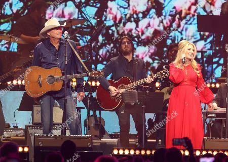Alan Jackson, Lee Ann Womack. Alan Jackson, left, and Lee Ann Womack, perform at Loretta Lynn's 87th Birthday Tribute at Bridgestone Arena, in Nashville, Tenn