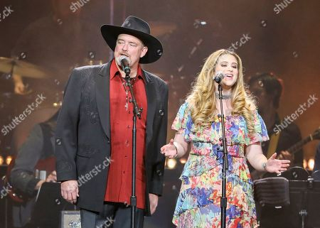 John Carter Cash, Ana Cristina Cash. John Carter Cash and Ana Cristina Cash perform at Loretta Lynn's 87th Birthday Tribute at Bridgestone Arena, in Nashville, Tenn