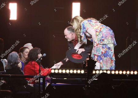 John Carter Cash, Ana Cristina Cash, Loretta Lynn. John Carter Cash and Ana Cristina Cash greet Loretta Lynn at Loretta Lynn's 87th Birthday Tribute at Bridgestone Arena, in Nashville, Tenn