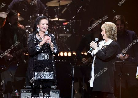 Crystal Gayle, Peggy Sue. Crystal Gayle, left, and Peggy Sue perform at Loretta Lynn's 87th Birthday Tribute at Bridgestone Arena, in Nashville, Tenn