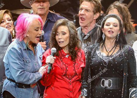 Loretta Lynn, Tanya Tucker, Crystal Gayle. Loretta Lynn, center, Tanya Tucker, left, and Crystal Gayle, right perform at Loretta Lynn's 87th Birthday Tribute at Bridgestone Arena, in Nashville, Tenn