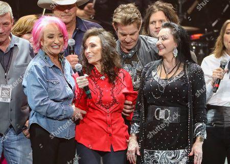 Stock Image of Loretta Lynn, Tanya Tucker, Crystal Gayle. Loretta Lynn, center, Tanya Tucker, left, and Crystal Gayle, right perform at Loretta Lynn's 87th Birthday Tribute at Bridgestone Arena, in Nashville, Tenn