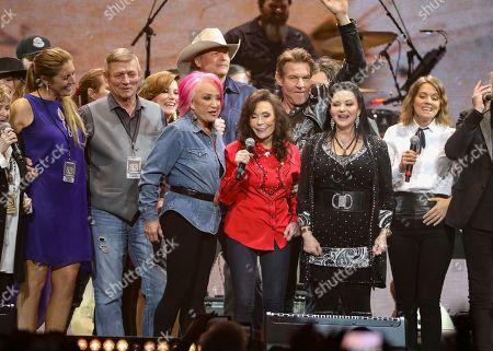 Loretta Lynn, center, performs at Loretta Lynn's 87th Birthday Tribute at Bridgestone Arena, in Nashville, Tenn