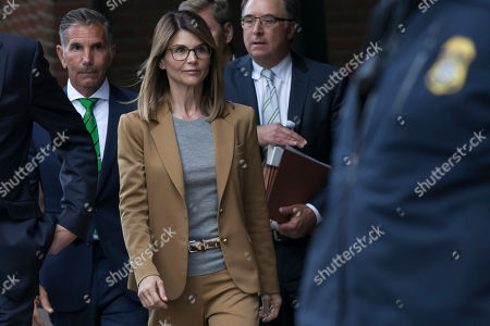 US actress Lori Loughlin (C) and her husband Mossimo Giannulli (L) leave the John J Moakley Federal Court House after facing charges in a nationwide college admissions cheating scheme in Boston, Massachusetts, USA 03 April 2019.