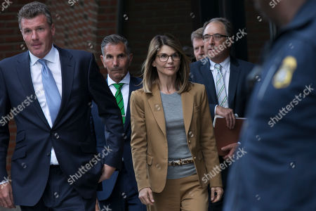 US actress Lori Loughlin (C) and her husband Mossimo Giannulli (2nd L) leave the John J Moakley Federal Court House after facing charges in a nationwide college admissions cheating scheme in Boston, Massachusetts, USA 03 April 2019.