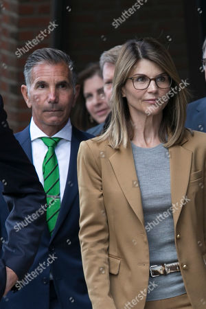US actress Lori Loughlin (R) and her husband Mossimo Giannulli (L) leave the John J Moakley Federal Court House after facing charges in a nationwide college admissions cheating scheme in Boston, Massachusetts, USA 03 April 2019.