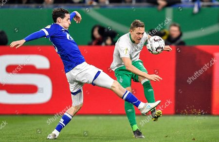 Bremen's Ludwig Augustinsson, right, and Schalke's Sebastian Rudy challenge for the ball during the German soccer cup, DFB Pokal, quarterfinal match between FC Schalke 04 and Werder Bremen in Gelsenkirchen, Germany
