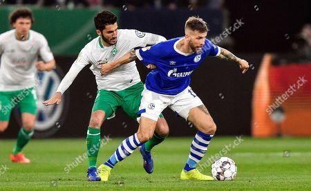 Schalke's Guido Burgstaller, right, and Bremen's Nuri Sahin challenge for the ball during the German soccer cup, DFB Pokal, quarterfinal match between FC Schalke 04 and Werder Bremen in Gelsenkirchen, Germany