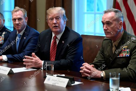 Donald Trump, Patrick Shanahan, Joseph Dunford. President Donald Trump, center, flanked by acting Defense Secretary Patrick Shanahan, left, and Chairman of the Joint Chiefs of Staff Gen. Joseph Dunford, right, speaks during a meeting with military leaders in the Cabinet Room of the White House in Washington
