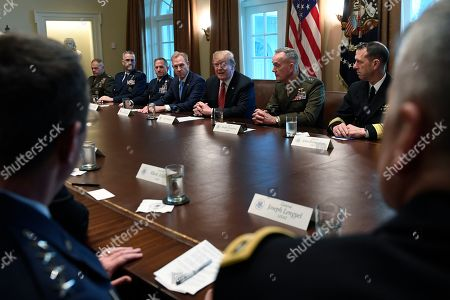 Donald Trump, Patrick Shanahan, Joseph Dunford. President Donald Trump, fourth from right, flanked by acting Defense Secretary Patrick Shanahan, fifth from left, and Chairman of the Joint Chiefs of Staff Gen. Joseph Dunford, third from right, speaks during a meeting with military leaders in the Cabinet Room of the White House in Washington