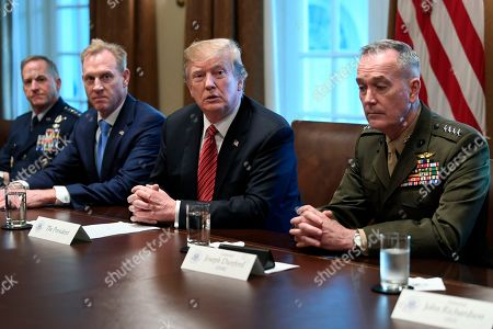 Donald Trump, Patrick Shanahan, Joseph Dunford. President Donald Trump, second from right, flanked by acting Defense Secretary Patrick Shanahan, second from left, and Chairman of the Joint Chiefs of Staff Gen. Joseph Dunford, right, speaks during a meeting with military leaders in the Cabinet Room of the White House in Washington, . At left is Air Force Chief of Staff Gen. David Goldfein