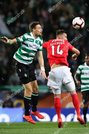 Sporting player Sebastian Coates (L) in action against Benfica's Haris Seferovic during their Portugal Cup second leg semi final soccer match held at Alvalade Stadium, Lisbon, Portugal, 3 April 2019.