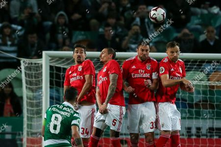 Sporting player Bruno Fernandes (L) scores a free kick against Benfica during their Portugal Cup second leg semi final soccer match held at Alvalade Stadium, Lisbon, Portugal, 03 April 2019.