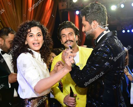 Bollywood actors Tapasee Pannu and Vicky Kaushal with actor Ranveer Singh