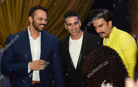 Bollywood actors Ranveer Singh and Akshay Kumar with filmmaker Rohit Shetty