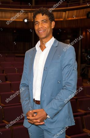 Paul Laverty, Iciar Bollian, Carlos Acosta, Andrea Calderwood. Dancer Carlos Acosta poses for photographers upon arrival for premiere of Yuli: The Carlos Acosta Story, on stage at the Royal Opera House in central London