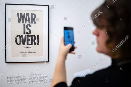 """A visitor photographs the work """"War is over"""" of the Japanese-American artist Yoko Ono during the opening of the exhibition 'PEACE is POWER' in the Museum of the Fine Arts (Museum der bildenden Kuenste) in Leipzig, Germany, 03 April 2019. Yoko Ono presents her most extensive exhibition of works in Leipzig since her retrospective in the Schirn Kunsthalle in Frankfurt five years ago."""