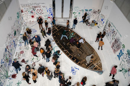 """Visitors at the work """"Add colour painting (Refugee boat)"""" of the Japanese-American artist Yoko Ono during the opening of the exhibition 'PEACE is POWER' in the Museum of the Fine Arts (Museum der bildenden Kuenste) in Leipzig, Germany, 03 April 2019. Yoko Ono presents her most extensive exhibition of works in Leipzig since her retrospective in the Schirn Kunsthalle in Frankfurt five years ago."""