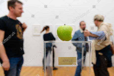"""Visitors look at the work """"Apple"""" of the Japanese-American artist Yoko Ono during the opening of the exhibition 'PEACE is POWER' in the Museum of the Fine Arts (Museum der bildenden Kuenste) in Leipzig, Germany, 03 April 2019. Yoko Ono presents her most extensive exhibition of works in Leipzig since her retrospective in the Schirn Kunsthalle in Frankfurt five years ago."""