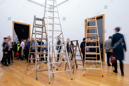 """Visitors look at the work """"Skyladders"""" of the Japanese-American artist Yoko Ono during the opening of the exhibition 'PEACE is POWER' in the Museum of the Fine Arts (Museum der bildenden Kuenste) in Leipzig, Germany, 03 April 2019. Yoko Ono presents her most extensive exhibition of works in Leipzig since her retrospective in the Schirn Kunsthalle in Frankfurt five years ago."""