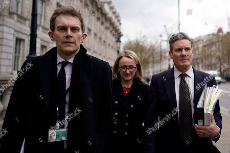 Shadow Brexit Secretary Keir Starmer (R) Labour Party's Executive Director of Strategy and Communications Seumas Milne (L) and Shadow Secretary of State for Business Rebecca Long Bailey (C) depart the Cabinet Office following cross party talks in London, Britain, 04 April 2019. Labour leader Jeremy Corbyn is to hold further talks with British Prime Minister Theresa May over Brexit on later in the day.