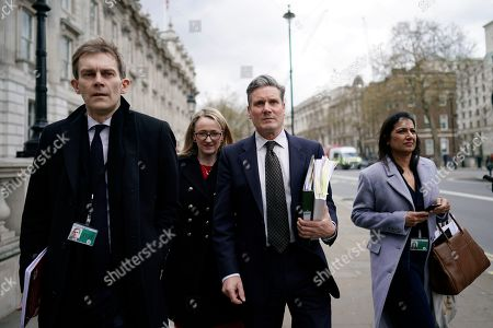 Stock Photo of Shadow Brexit Secretary Keir Starmer (2-R), Labour Party's Executive Director of Strategy and Communications Seumas Milne (L), Shadow Secretary of State for Business Rebecca Long Bailey (2-L) and Labour MP Rupa Huq (R) depart the Cabinet Office following cross party talks in London, Britain, 04 April 2019. Labour leader Jeremy Corbyn is to hold further talks with British Prime Minister Theresa May over Brexit on later in the day.