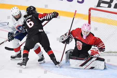 Stock Photo of Lara Escudero (L) of France in action against Japanese players Sena Suzuki (C) and goalie Nana Fujimoto (R) during the 2019 IIHF Ice Hockey Women's World Championship match between France and Japan in Espoo, Finland, 04 April 2019.
