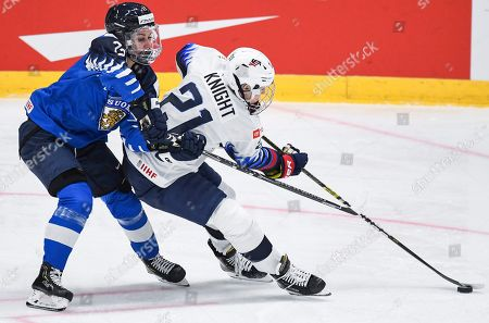 Susanna Tapani (L) of Finland in action against Hilary Knight (R) of the USA during the 2019 IIHF Ice Hockey Women's World Championship match between Finland and the USA in Espoo, Finland, 04 April 2019.