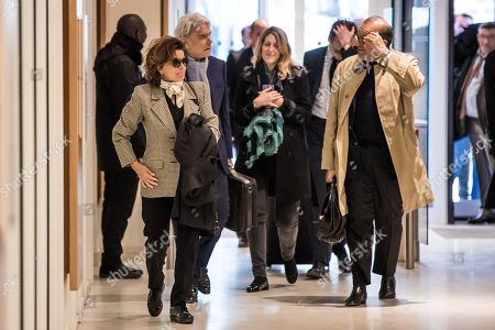 French tycoon Bernard Tapie (2-L), flanked by wife Dominique (L) and his lawyer Herve Temime (R), arrives at the Tribunal de Paris courthouse for the last day of his trial, in Paris, France, 04 April 2019. French businessman Bernard Tapie goes on trial over a compensation of 404 million euros in 2008, to settle a long-running legal dispute following a fraught 1993 corporate deal regarding the sale of his sportswear company Adidas. The case involves Christine Lagarde, now head of the International Monetary Fund (IMF) but at the time Finance minister of Nicolas Sarkozy's government, and her former chief of staff, Stephane Richard, now chief executive of Orange, among others.