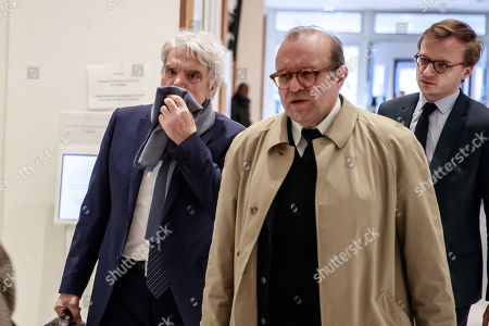 French tycoon Bernard Tapie (L) and his lawyer Herve Temime (C), arrive at the Tribunal de Paris courthouse for the last day of his trial, in Paris, France, 04 April 2019. French businessman Bernard Tapie goes on trial over a compensation of 404 million euros in 2008, to settle a long-running legal dispute following a fraught 1993 corporate deal regarding the sale of his sportswear company Adidas. The case involves Christine Lagarde, now head of the International Monetary Fund (IMF) but at the time Finance minister of Nicolas Sarkozy's government, and her former chief of staff, Stephane Richard, now chief executive of Orange, among others.