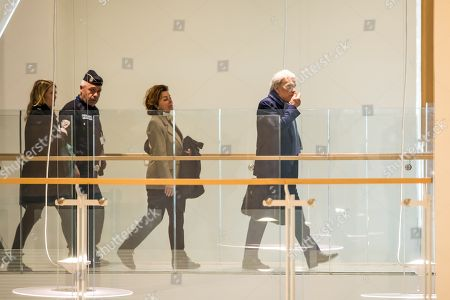 French tycoon Bernard Tapie (R), followed by his wife Dominique Tapie (C) arrives at the Tribunal de Paris courthouse for the last day of his trial, in Paris, France, 04 April 2019. French businessman Bernard Tapie goes on trial over a compensation of 404 million euros in 2008, to settle a long-running legal dispute following a fraught 1993 corporate deal regarding the sale of his sportswear company Adidas. The case involves Christine Lagarde, now head of the International Monetary Fund (IMF) but at the time Finance minister of Nicolas Sarkozy's government, and her former chief of staff, Stephane Richard, now chief executive of Orange, among others.