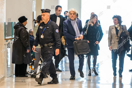 French tycoon Bernard Tapie (C), followed by his wife Dominique Tapie (R) arrives at the Tribunal de Paris courthouse for the last day of his trial, in Paris, France, 04 April 2019. French businessman Bernard Tapie goes on trial over a compensation of 404 million euros in 2008, to settle a long-running legal dispute following a fraught 1993 corporate deal regarding the sale of his sportswear company Adidas. The case involves Christine Lagarde, now head of the International Monetary Fund (IMF) but at the time Finance minister of Nicolas Sarkozy's government, and her former chief of staff, Stephane Richard, now chief executive of Orange, among others.