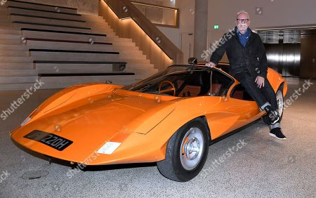 Stock Picture of Malcolm McDowell relives A Clockwork Orange in Probe 16 car, part of the Stanley Kubrick: The Exhibition