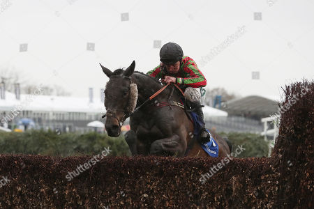 Leighton Aspell riding Movie Legend clears the last fence during The Close Brothers Red Rum Handicap Steeple Chase