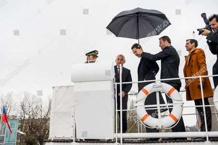 """H.R.H. Hereditary Prince Alois of Liechtenstein, 3rd left, and Swiss Federal President Ueli Maurer, 2nd left, react on the """"Italie"""" steam boat to the Compagnie Generale de Navigation (CGN) during a cruise on the lake Geneva as part of a two day state visit to Switzerland, in Lausanne, Switzerland, 04 April 2019."""