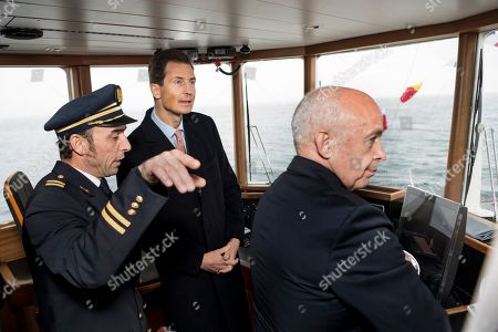 """H.R.H. Hereditary Prince Alois of Liechtenstein, left, and Swiss Federal President Ueli Maurer, right, react on the """"Italie"""" steam boat to the Compagnie Generale de Navigation (CGN) during a cruise on the lake Geneva as part of a two day state visit to Switzerland, in Lausanne, Switzerland, 04 April 2019."""